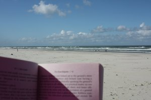 Reading on the beach on holiday